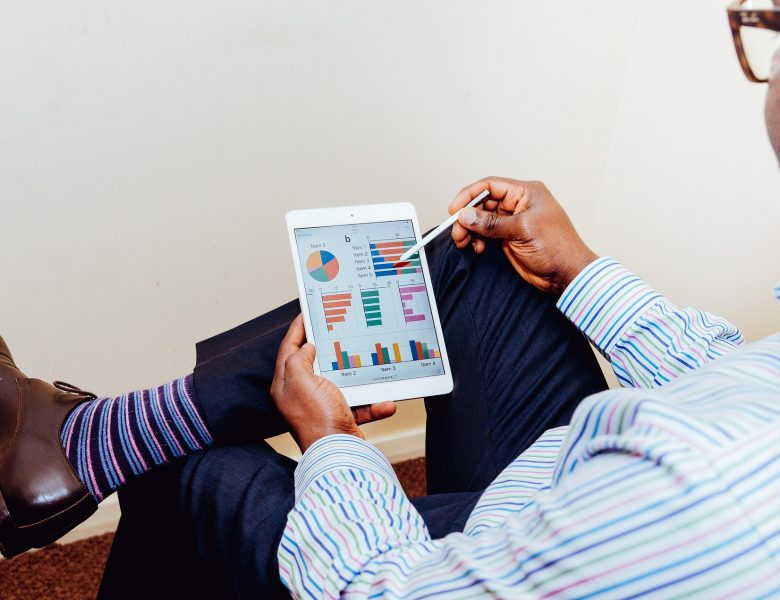 Business graph watching on tablet for good